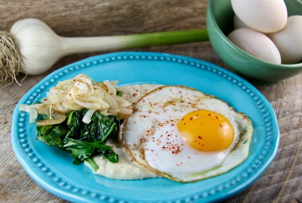 Savory Breakfast Polenta with Eggs, Sautéed Onions, and Spinach