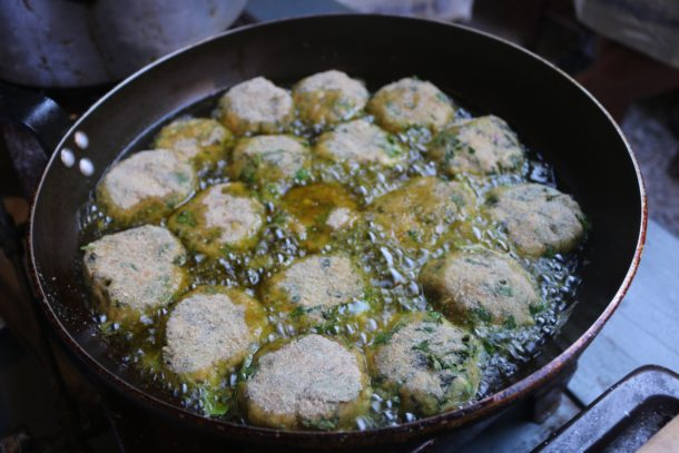 Mediterranean Diet: Zucchini Fritters frying in olive oil